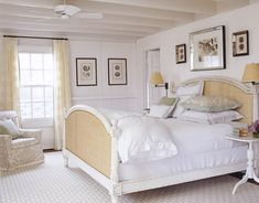 Beach house coastal inspiring bedroom with upholstered headboard