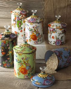 """Canister with floral design crafted of enameled steel with ceramic finish. Bronzed stainless-steel trim. Hand wash. 5""""Dia. x 7.5""""T (including lid); holds 38 ounces. Imported."""