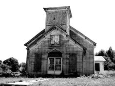 Black and white photograph of an abandoned and boarded-up church in the deserted former downtown of Adams, Tennessee. On the day this photograph was made, a mockingbird in the steeple was loudly protesting my presence. Abandoned Churches, Old Churches, Abandoned Places, Spooky Places, Haunted Places, Creepy History, Old Country Churches, Church Building, Most Haunted