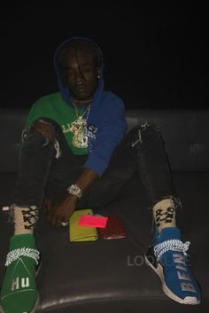 Lil Uzi Vert wearing  Off-White c/o Virgil Abloh Reassembled Hoodie, Adidas Pharrell NMD Sneaker, Adidas PW Human Race Sneaker