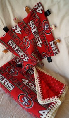 NFL San Francisco Football Fleece Minky 30 x 36 Blanket and matching Taggie Sensory Lovey Nfl 49ers, 49ers Fans, Crochet Blankets, Baby Blankets, Aphgan Patterns, Blanket Gifts, Sewing Machine Projects, Nfl San Francisco, Football Art