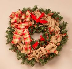 Celebrate the season with a brand new Burlap Christmas Wreath for your front door. Learn how to make yours, using a plain pine wreath from Pat Catan's.