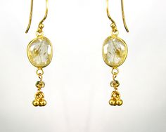 rutilated quartz and vermeil earrings . Exotic golden earrings with vermeil bezel framed stone and tiny rondelles