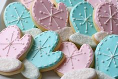Winter decorated sugar cookies. Royal icing. Blue, pink, white. Mitten.