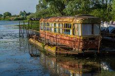 "abandonedography: ""  Tram house boat on the Desna River, Ukraine. (photo: Sergei Rzhevsky) """