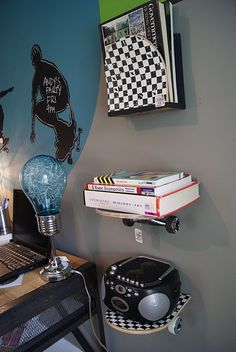 Shelving from skateboard. Awesome boys room.