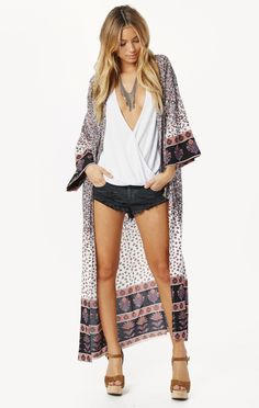 GYPSY DUSTER We're dreaming of the open road, good luck crystals, daisy chains and dusty old mix tapes with the Auguste Gypsy Duster. A slimmer take on traditional Kimono sleeves, this is perfect for layering piece with a jacket for those colder nights thanks to a floor grazing design. Floral with an oriental touch, this Kimono is perfect with denim or a little white romper and some well-worn booties.