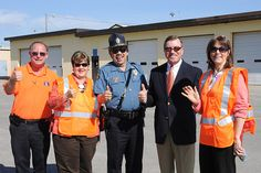 KHP Col. Ernest Garcia, center, joins Kansas Turnpike Authority employees at the work zone safety event in Topeka on April 24. Learn more about work zone safety at www.ksdot.org. April 24, 12 Days Of Christmas, Kansas, Safety, Author, Orange, Security Guard, Writers