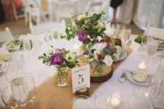 August wedding centerpiece. Grouping of three vases with wood slice. So pretty!