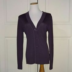 Tory Burch Purple Cardigan Tory Burch purple cardigan. It is pre owned. Has some pilling and has two small  on the back side. Not very noticeable. Still has plenty of life left and so comfy to wear. Tory Burch Sweaters Cardigans
