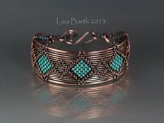 Hand woven copper bracelet with seed beads added while weaving.