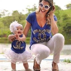 Mommy and daughter matching outfits.