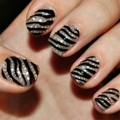 Silver, stripes and diamonds, oh my! We love nail art!