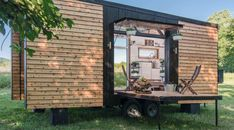 "A home might not be big, but this one manages to pack a mighty punch. The aptly named Alpha Tiny Home, which recently caught the limelight on HGTV's ""Tiny House, Big Living,"" … Cedar Siding, Wood Siding, Glass Garage Door, Sliding Glass Door, Jacuzzi, Alpha Tiny House, Tiny House France, Cheap Mobile Homes, Walnut Hardwood Flooring"