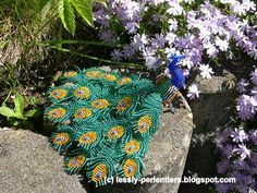 "Pretty little beaded peacock done by Lesslie Kleine. Instructions come from a book ""Animaux en perles"" but since there are a couple of books called this, I'm not sure which she meant. Her site is lessly-perlentiere.blogspot.ca"