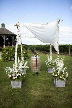 Aged Barrel & Birch Tree Chuppah at Ceremony | Photography: Christian Oth Studio. Read More:  http://www.insideweddings.com/weddings/classic-vineyard-wedding-in-the-hamptons/348/