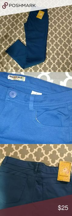 NWT. Blue, crop, skinny pants! Brand New. Perfect condition. Stretchy material: 60% Cotton, 25% Polyester, 10% Rayon, 5% Spandex. Love Sweet Pants Ankle & Cropped