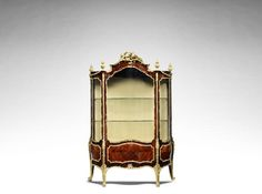 A large French late 19th century Louis XV style gilt-bronze mounted kingwood and marquetry vitrine