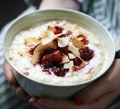 Make comforting porridge even more creamy with coconut milk. Stew oranges and cranberries for the topping, then sprinkle on toasted coconut