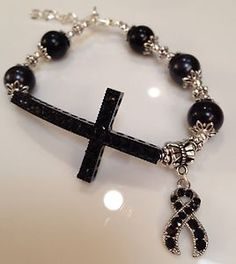 Black ribbon with side cross for melanoma awareness