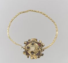 One of a Pair of Gold Earrings with Garnets  Date: second half 8th century Geography: Made in, Northern France Culture: Frankish Medium: Gold, garnets with foil backings, silver studs/rivets Dimensions: Overall: 1 13/16 x 1 3/4 x 1/2 in. (4.6 x 4.5 x 1.3 cm) bead: 13/16 x 1/2 in. (2 x 1.3 cm)