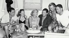 Rita Hayworth with a belated celebration of her 28th birthday on Errol Flynn's yacht, The Zaca. We have Errol, his wife Nora Eddington, Rita, Orson Welles, actor and Navy Veteran, Richard Denning and screenwriter, William Castle ~ November 19, 1946
