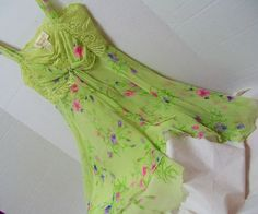 Victoria Secret, Short Night Gown. Spring Green, Floral Printed Sheer Chiffon, Size Small, Honeymoon, Date Night, Resort Cruise Wear Adjustable spaghetti straps Stretch Lace bodice Tie front bow Full and Flirty  Pristine Find – never worn – no flaws or issues to state  Details MARKED A SIZE SMALL  Bust approx 32 - 34 Total Length approx 29  Label Victoria Secret Fabric Chiffon polyester Lace nylon and spandex Care washable  PLEASE READ DETAILS AND MEASUREMENTS CAREFULLY. (DOUBLE CHECK THEM)…