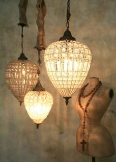 Lampshades or Chadeliers... either way they are fab!! I can see them in my bedroom.. over the vanity.