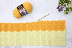 Pretty! Every new baby deserves a warm welcome into the world and this easy crochet baby blanket pattern puts a modern twist on the traditional ripple. Made using Lion Brand's Baby Soft yarn in Lemon Drop and Pastel Yellow.