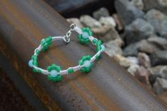 Green and Baby Blue Beaded Flower Bracelet  White by WingoWorks, $11.00