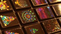 Morphotonix has given traditional Swiss chocolate-making a colorful twist: It's devised a method to imprint shiny holograms. #chocolate #holograms