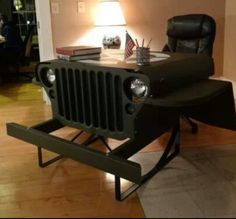 This Jeep Willys MB desk has a real grille, headlamps, blackout lamps and dash plaque.