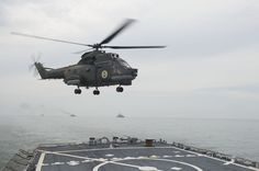 160613-N-FQ994-346 BLACK SEA (June 13, 2016) A Romanian navy IAR-330 medium helicopter lands aboard USS Porter (DDG 78) during a passing exercise in the Black Sea June 13, 2016. Porter, an Arleigh Burke-class guided-missile destroyer, forward-deployed to Rota, Spain, is conducting a routine patrol in the U.S. 6th Fleet area of operations in support of U.S. national security interests in Europe. (U.S. Navy photo by Mass Communication Specialist 3rd Class Robert S. Price/Released)