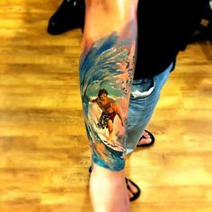 Big wave surfer tattoo