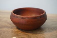 Hand turned Sapele wood bowl.   The bowl measures 130mm (5) in diameter by 60mm (2.5) in height. http://jgriffindesign.co.uk/