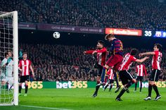 Gerard Pique of FC Barcelona heads the ball towards goal and scores his team's second goal during the Copa del Rey Quarter Final Second Leg between FC Barcelona and Athletic Club at Camp Nou stadium on January 27, 2016 in Barcelona