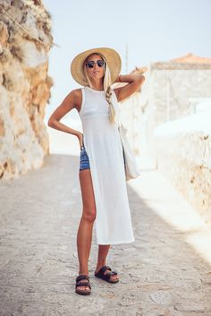 Why not breeze onto like Janni Dellerin this long white shirt over denim shorts and a your favourite bikini top!Top: River Island, Shorts: Berska, Shoes:Birkenstock