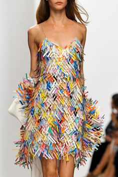 Hussein Chalayan - bright, bold colours which contrast together, also the dress style is quite unusual which reminds me of the Mad Hatter character.