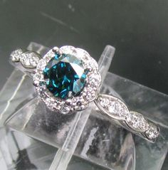 Blue Diamond Engagement Ring In 14k Gold and Diamond Halo Setting Matching Band Available. $1,130.00, via PristineJewelry on Etsy. This ring makes me want a blue diamond, I love it