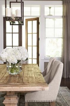 I think this will be happening in my future - rustic farmhouse table paired with sleek fabric dining chairs. by Linda McDougald Design | Postcard from Paris Home
