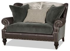 Fall in love with all the textures and variety of leathers used on this Settee.