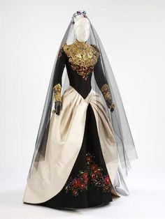 """""""Wedding dress, 'Qui a le droit?', Christian Lacroix Couture, Paris, autumn/winter 1993-4. (Also pictured on home page.) Silk satin, embellished with gold leaf, foil, beads, paste gems and chenille embroidery."""""""