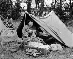 Military Woman Sitting in Tent, July, 1944.