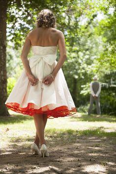 pop of red crinoline under a wedding dress