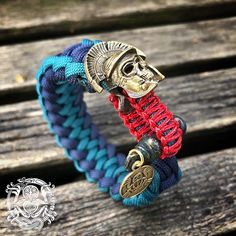 The Snarling Wolf paracord bracelet – Kruger EDC Paracord Bracelets, Bracelets For Men, Greenies Dog Treats, Snarling Wolf, Shark Jaws, Grey Pictures, Weaving, Bronze, Brass