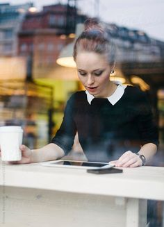 Young business woman using technology sitting at cafe by Simone Becchetti Business Portrait, Business Photos, Business Outfits, Business Fashion, Business Women, Photography Women, Photography Business, Lifestyle Photography, Portrait Photography
