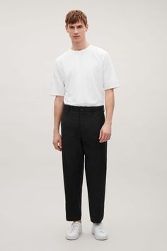 COS image 1 of Relaxed lightweight wool trousers in Black