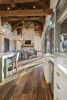 Home Remodeling Rustic Kitchen with real reclaimed plank hardwood flooring barn wood shiplap ceiling and 100 year old timber beams and rafters Barn Wood Decor, Rustic Barn, Barn House Decor, Rustic Lake Houses, Rustic House Plans, Farmhouse Floor Plans, Barn House Plans, Farm House, Rustic Decor