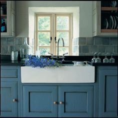 Blue rustic kitchen cabinets, white farmhouse apron front sink | Fired earth products in France - lulu klein interiors
