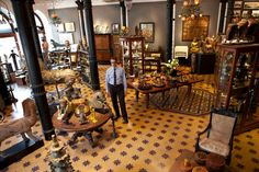 Phillips Antiques, a family run business located in Mumbai, India. Owner Farooq Issa in the showroom of Indian Art and Antiquities.